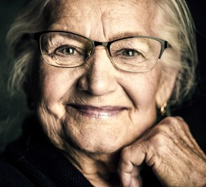 Portrait of a beautiful senior woman in elegant glasses smiling at camera assisted living facilities middlesex worcester MA
